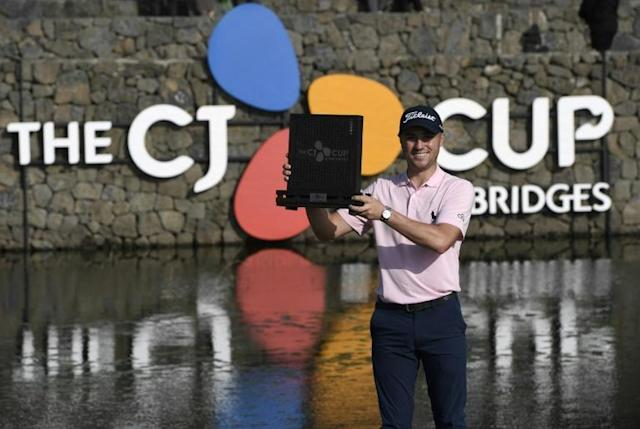 Justin Thomas with the trophy after winning the CJ Cup (AFP Photo/Jung Yeon-je)