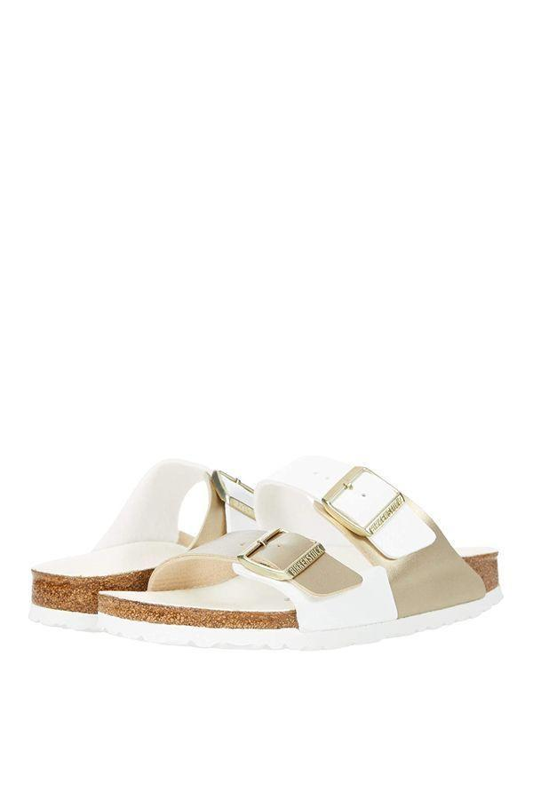 """<p><strong>Birkenstock</strong></p><p>zappos.com</p><p><strong>$115.00</strong></p><p><a href=""""https://go.redirectingat.com?id=74968X1596630&url=https%3A%2F%2Fwww.zappos.com%2Fp%2Fbirkenstock-arizona-split-white-gold-birko-florr%2Fproduct%2F9463212&sref=https%3A%2F%2Fwww.oprahdaily.com%2Fstyle%2Fg25893553%2Fbest-sandals-for-women%2F"""" rel=""""nofollow noopener"""" target=""""_blank"""" data-ylk=""""slk:SHOP NOW"""" class=""""link rapid-noclick-resp"""">SHOP NOW</a></p><p>It's hard to go wrong with a trusty, durable pair of Birkenstocks. They lend an effortless spirit to just about everything, from athleisure to floral dresses, which makes them totally worth it in our humble opinion. Try this white and metallic take for a fresh spin.</p>"""