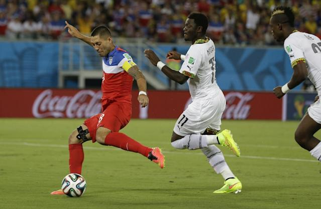United States' Clint Dempsey shoots and scores the opening goal during the group G World Cup soccer match between Ghana and the United States at the Arena das Dunas in Natal, Brazil, Monday, June 16, 2014. (AP Photo/Ricardo Mazalan)