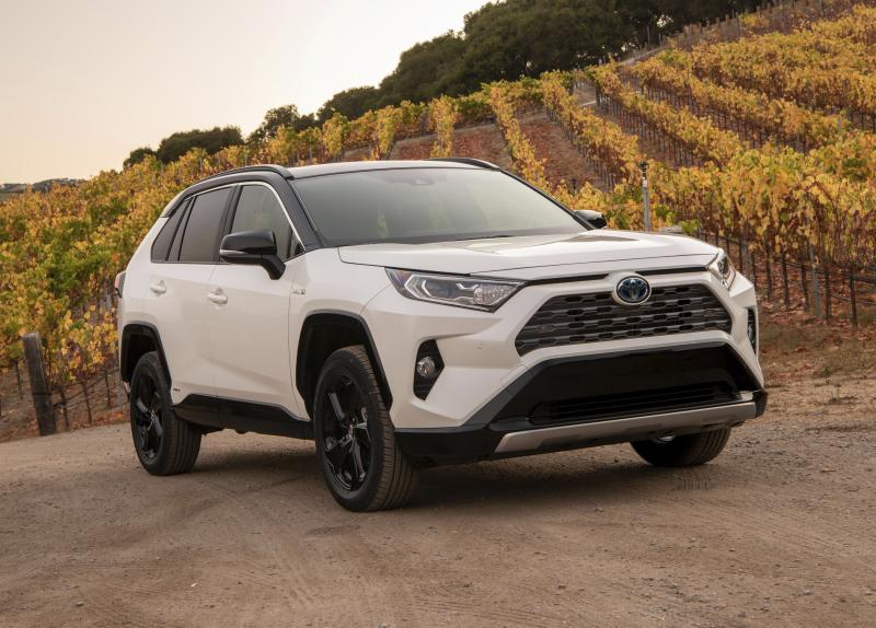 This undated photo provided by Toyota shows the 2020 RAV4 Hybrid, a compact SUV with an EPA-estimated 40 mpg in mixed driving. (Toyota Motor Sales USA via AP)