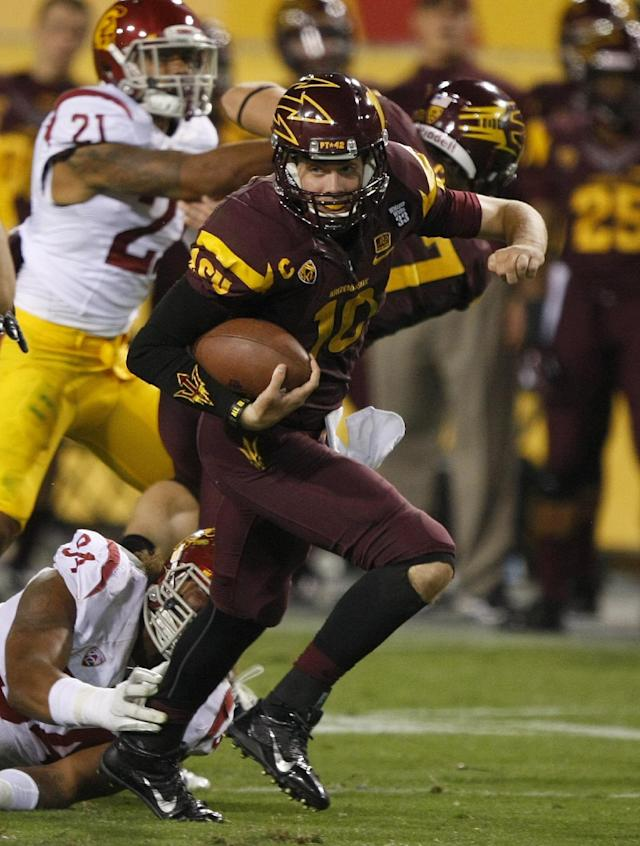 Arizona State quarterback Taylor Kelly (10) runs for a first down against Southern California in the second half during an NCAA college football game on Saturday, Sept. 28 2013, in Tempe, Ariz. The Sun Devils defeated the Trojans 62-41. (AP Photo/Rick Scuteri)