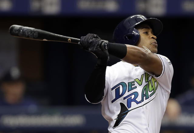 Tampa Bay Rays' Mallex Smith follows through on his RBI triple off Seattle Mariners starting pitcher Felix Hernandez during the third inning of a baseball game Saturday, June 9, 2018, in St. Petersburg, Fla. (AP Photo/Chris O'Meara)