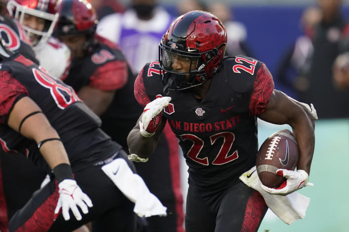 San Diego State running back Greg Bell (22) runs the ball during the second half of an NCAA college football game against Utah Saturday, Sept. 18, 2021, in Carson, Calif. (AP Photo/Ashley Landis)