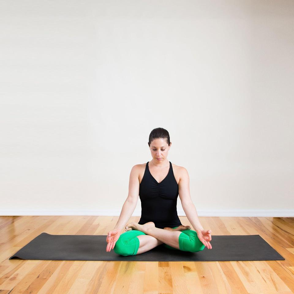 "<p>This is a simple, meditative pose to help you center yourself and calm your thoughts, recommended by <a href=""https://fitonapp.com/"" class=""link rapid-noclick-resp"" rel=""nofollow noopener"" target=""_blank"" data-ylk=""slk:FitOn"">FitOn</a> trainer and yoga instructor <a href=""https://www.instagram.com/meditatingwithdeandre/"" class=""link rapid-noclick-resp"" rel=""nofollow noopener"" target=""_blank"" data-ylk=""slk:DeAndre Sinette"">DeAndre Sinette</a>, RYT 200. ""It's simply sitting with your ankles crossed,"" he said. ""This posture permits me to practice meditation in a way that is present and alert. My spine is erect and my shoulders are being pressed down by gravity. Sweet like honey.""</p> <ul> <li>Sit with your legs crossed, or prop yourself up on a stiff pillow, a thick, folded blanket, or a large towel to elevate your hips. Get comfortable.</li> <li>Root your seat down as you lengthen your spine, gently tucking your chin and lifting the crown of your head.</li> <li>Place your palms facing up on your thighs to invite in more energy, or place your palms face down for a more grounding feeling.</li> <li>Sit in this position for one minute.</li> <li>If you like, you can use this time to set an intention with a word or a phrase that encompasses how you want to feel. If your mind starts to wander, use your breath and intention as an anchor.</li> </ul>"
