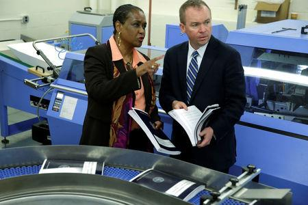 Office of Management and Budget (OMB) Director Mick Mulvaney (R) and Government Publishing Office Director Davita Vance-Cooks inspect the FY2018 budget production run in Washington, U.S., May 19, 2017. REUTERS/Yuri Gripas