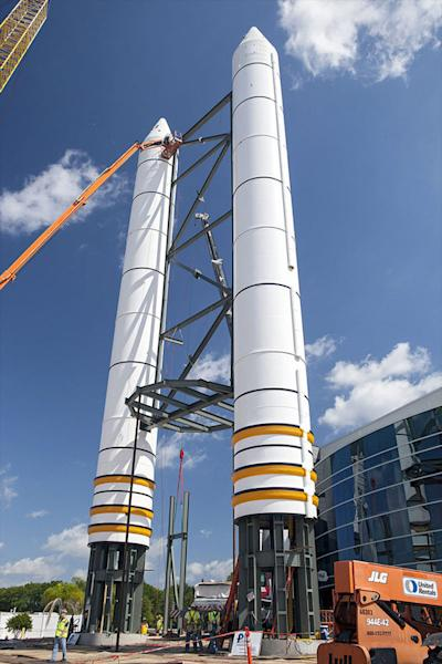 Solid rocket booster replicas are topped with nose cones outside the Space Shuttle Atlantis exhibit at the Kennedy Space Center Visitor Complex in Florida.