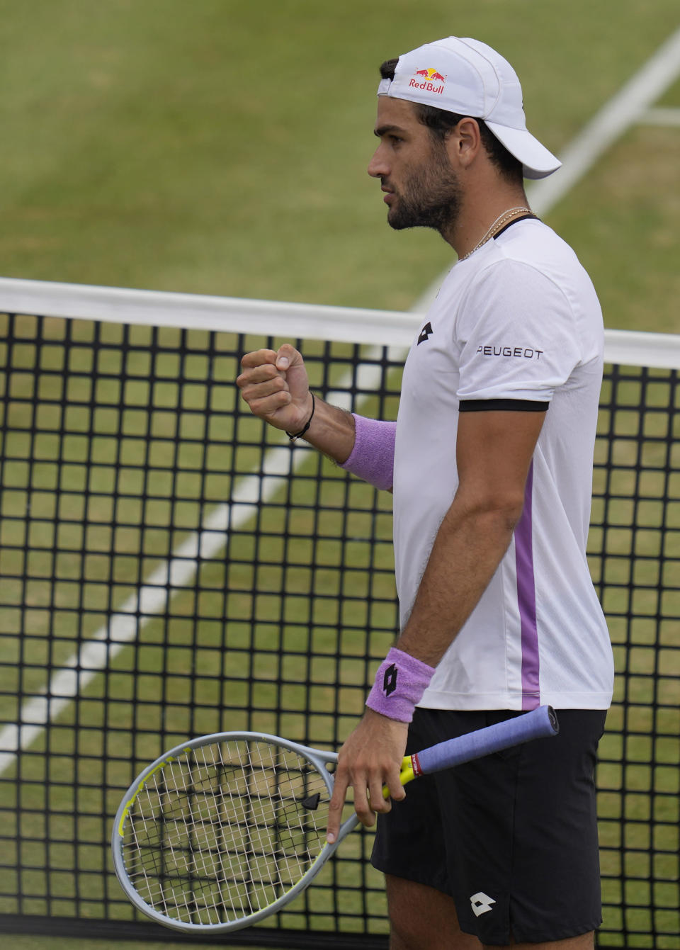 Matteo Berrettini of Italy celebrates winning at match point against Andy Murray of Britain during their singles tennis match at the Queen's Club tournament in London, Thursday, June 17, 2021. (AP Photo/Kirsty Wigglesworth)