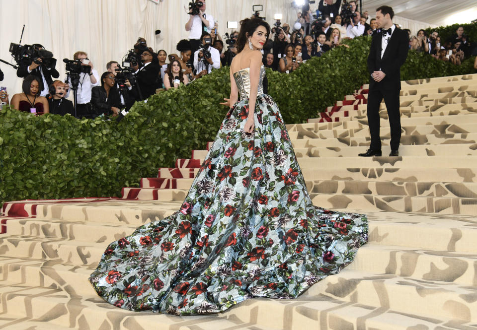 Amal Clooney attends The Metropolitan Museum of Art's Costume Institute benefit gala celebrating the opening of the Heavenly Bodies: Fashion and the Catholic Imagination exhibition on Monday, May 7, 2018, in New York. (Photo by Charles Sykes/Invision/AP)