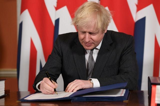Prime Minister Boris Johnson signs the EU-UK Trade and Cooperation Agreement at 10 Downing Street(Leon Neal/PA)