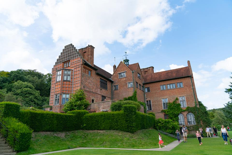 Westerham England - August 21 2019; Chartwell country house of Winston Churchill now part of National Trust as visitors to the estate walk along path below.