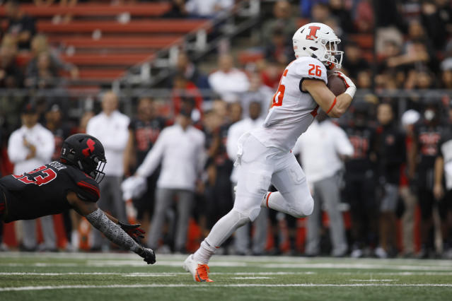FILE - In this Oct. 6, 2019, file photo, Illinois running back Mike Epstein gets away from Rutgers defensive back Kiy Hester on the way to a touchdown during the second half of an NCAA college football game in Piscataway, N.J. Epstein is back this year and ready to go, head coach Lovie Smith said. (AP Photo/David Boe, File)