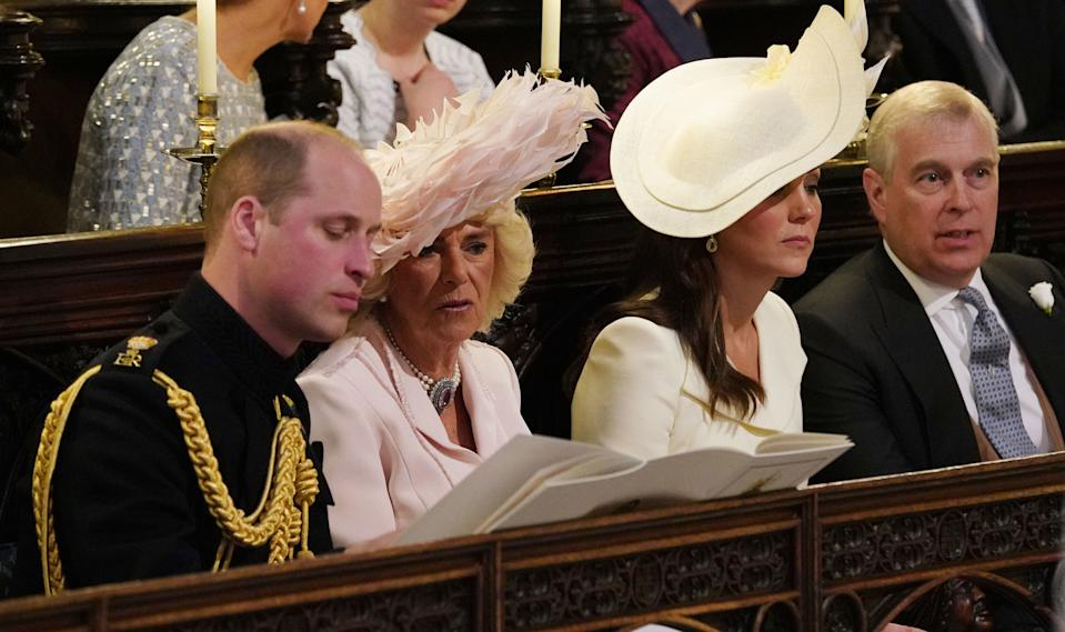 WINDSOR, UNITED KINGDOM - MAY 19:(Left to right) Prince William, Duke of Cambridge, Camilla, Duchess of Cornwall, Catherine, Duchess of Cambridge and Prince Andrew, Duke of York  attend the wedding of Prince Harry to Meghan Markle  at St George's Chapel at Windsor Castle on May 19, 2018 in Windsor, England. (Photo by Jonathan Brady - WPA Pool/Getty Images)