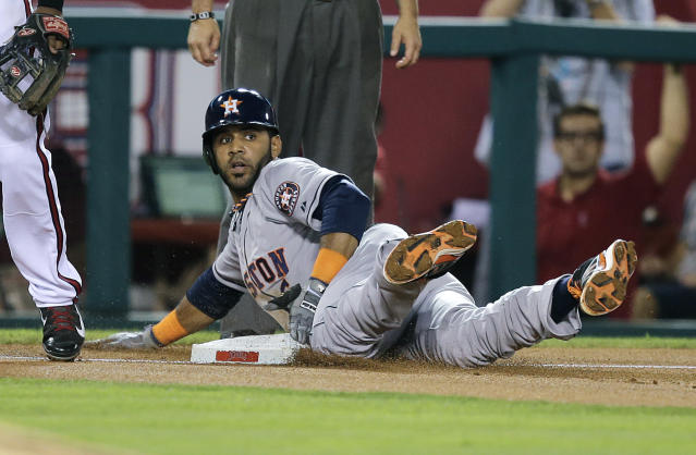 Houston Astros' Jonathan Villar takes third base on a throwing error by Los Angeles Angels starting pitcher Jerome Williams during the third inning of a baseball game Friday, Aug. 16, 2013, in Anaheim, Calif. (AP Photo/Jae C. Hong)