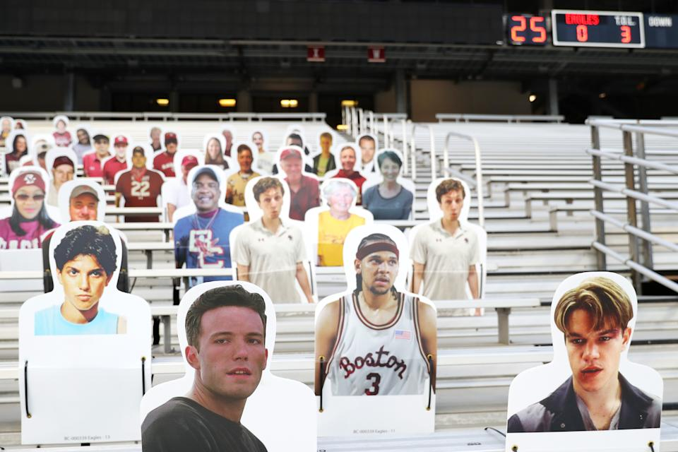 Cut-out photos of Matt Damon and Ben Affleck positioned in the stands at Alumni Stadium before a game between Boston College and Notre Dame on Nov. 14. (Maddie Meyer/Getty Images)