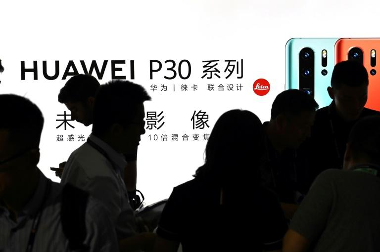 One possible solution to the Huawei standoff, according to an analyst, would be to ease US sanctions on the consumer business while maintaining restrictions on telecom infrastructure (AFP Photo/HECTOR RETAMAL)