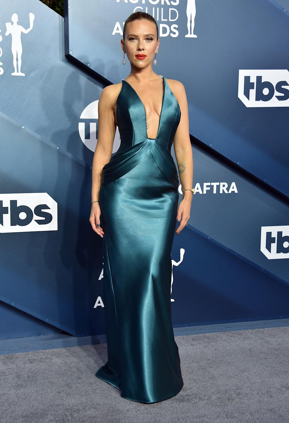 """The """"Marriage Story"""" and """"Jojo Rabbit"""" star wowed photographers with her plunging teal gown by Armani Privé."""
