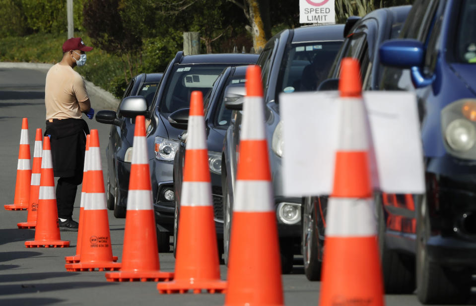 Motorists wait to take a COVID-19 test at a drive through community based assessment centre in Christchurch, New Zealand, Thursday, Aug. 13, 2020. Health authorities in New Zealand are scrambling to trace the source of a new outbreak of the coronavirus as the nation's largest city, Auckland, goes back into lockdown. (AP Photo/Mark Baker)