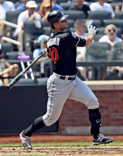 Miami Marlins' Justin Ruggiano hits a solo home run during the fourth inning of a baseball game against the New York Mets, Thursday, Aug. 9, 2012, at Citi Field in New York. (AP Photo/Seth Wenig)