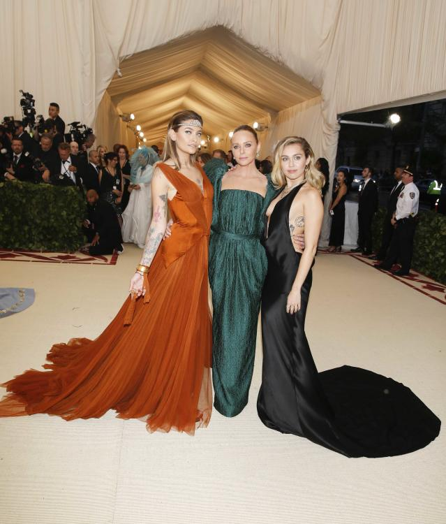 "Paris Jackson, Stella McCartney and Singer-Songwriter Miley Cyrus arrive at the Metropolitan Museum of Art Costume Institute Gala (Met Gala) to celebrate the opening of ""Heavenly Bodies: Fashion and the Catholic Imagination"" in the Manhattan borough of New York, U.S., May 7, 2018. REUTERS/Carlo Allegri"