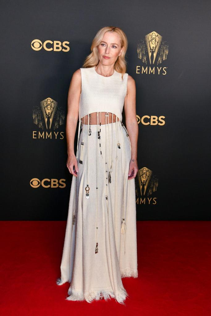 Gillian Anderson on the red carpet in a two piece white crop top and skirt combo