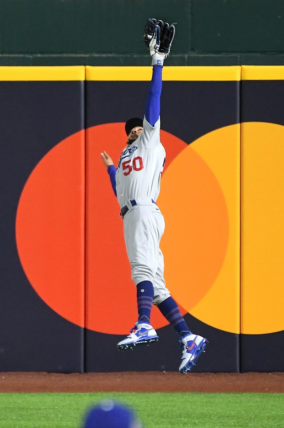 Dodgers right fielder Mookie Betts makes a leaping catch off the bat of Brandon Lowe in the second inning.