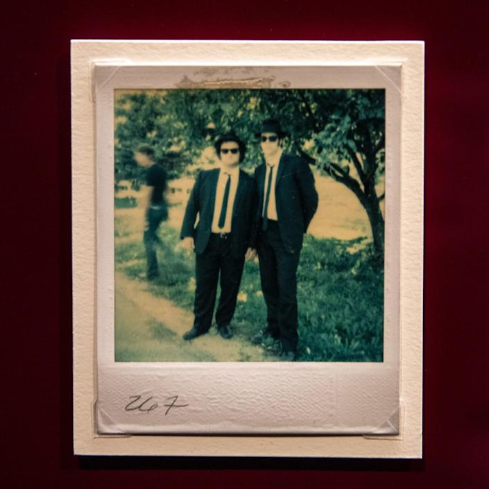 A Polaroid of two men wearing suits