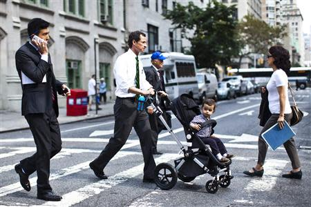 New York City Democratic mayoral candidate Anthony Weiner (C) pushes a stroller with his son, Jordan Weiner, as they arrive to the polling center during the primary election in New York September 10, 2013. REUTERS/Eduardo Munoz