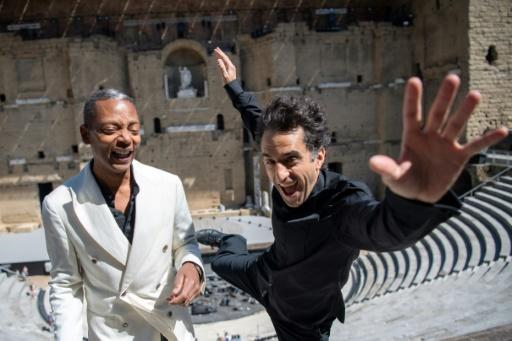 "Let it fly: Mills (left) with French conductor Christophe Maglou at the Orange music festival in southern France where he is performing his ""Light From The Outside World"" concert"
