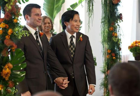 Phil Fung (R) and Shawn Klein, life-partners of 18 years, walk down the aisle after their marriage ceremony on the 61st floor of the Empire State Building in New York, February, 14, 2012.