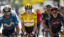 Spain's Enric Mas, Slovenia's Tadej Pogacar, wearing the overall leader's yellow jersey, Netherland's Wilco Kelderman and Richard Carapaz of Ecuador, from elft to right, cross the finish line of the fifteenth stage of the Tour de France cycling race over 191.3 kilometers (118.9 miles) with start in Ceret and finish in Andorra-la-Vella, Andorra, Sunday, July 11, 2021. (AP Photo/Christophe Ena)