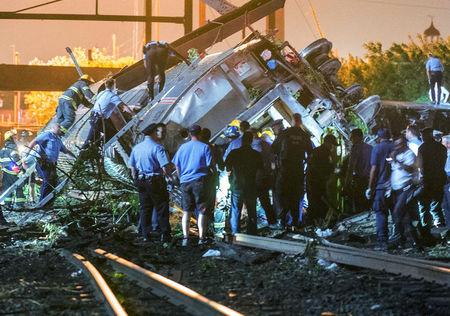 FILE PHOTO: Emergency responders search for passengers following an Amtrak train derailment in the Frankfort section of Philadelphia