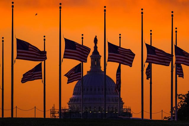 <p>Flags fly at half staff around the Washington Monument at daybreak, June 13, 2016. President Obama ordered flags lowered to honor the victims of the Orlando, Fla., nightclub shootings. (AP/David Ake) </p>