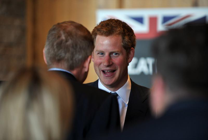 Britain's Prince Harry attends a reception at Club House of Sanctuary Golf Course in Sedalia, Colo., Friday, May 10, 2013. The visit is part of a weeklong visit to the United States that started in Washington and will also include trips to parts of New Jersey damaged by Superstorm Sandy. (AP Photo/The Denver Post, Hyoung Chang, Pool)