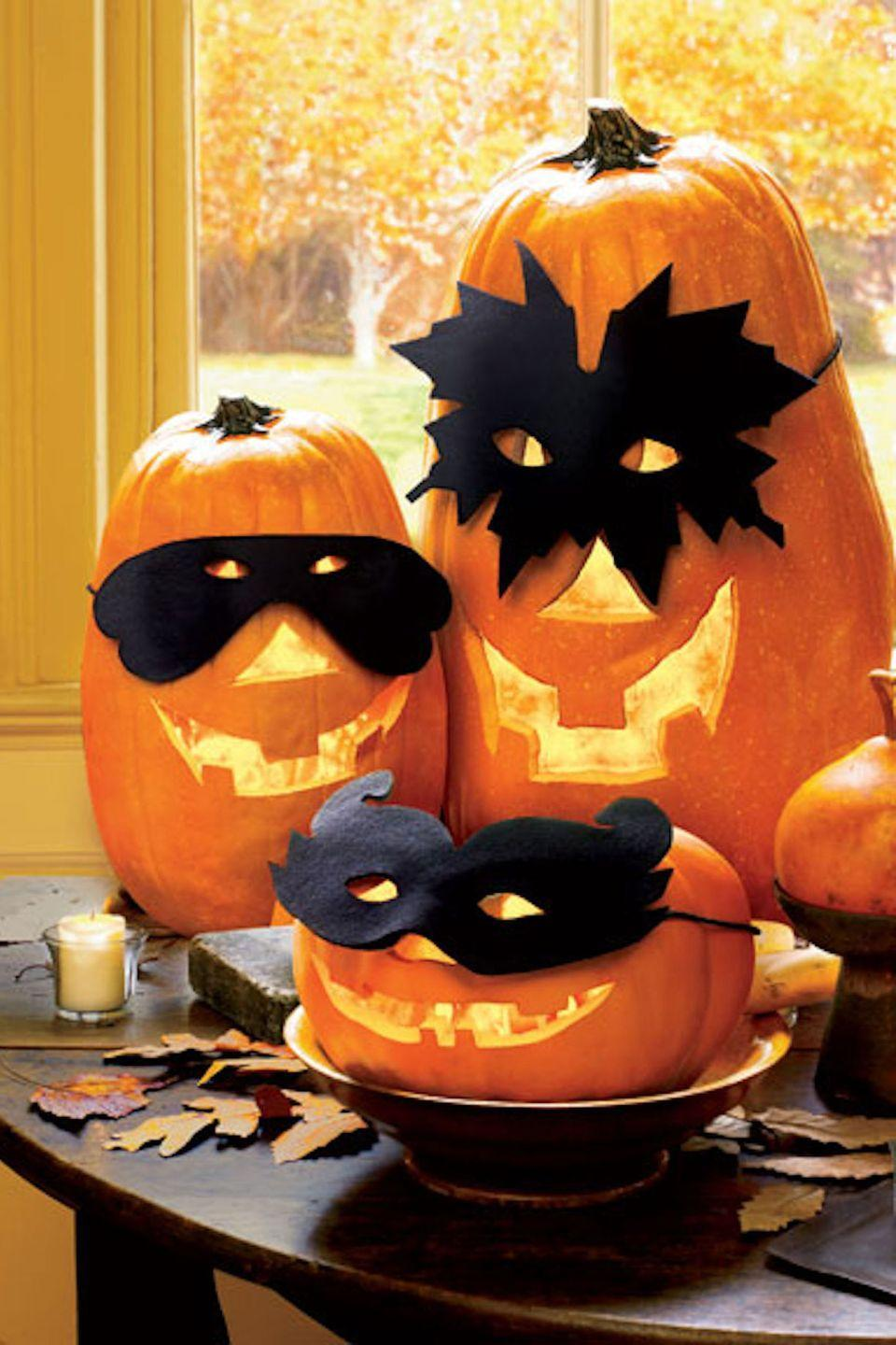 "<p>It's Halloween—why not dress up your pumpkins, too?</p><p><strong>Get the tutorial at <a href=""http://www.goodhousekeeping.com/holidays/halloween-ideas/a17493/halloween-pumpkin-masks-oct07/"" rel=""nofollow noopener"" target=""_blank"" data-ylk=""slk:Good Housekeeping"" class=""link rapid-noclick-resp"">Good Housekeeping</a>. </strong></p>"