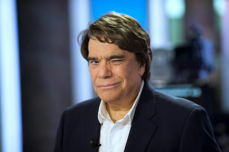 Bernard Tapie rose from modest beginnings to become one of France's most famous -- and controversial -- businessmen. (AFP/Fred DUFOUR)