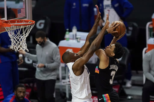 San Antonio Spurs guard Keldon Johnson shoots as Los Angeles Clippers forward Serge Ibaka defends during the first quarter of an NBA basketball game Tuesday, Jan. 5, 2021, in Los Angeles. (AP Photo/Ashley Landis)