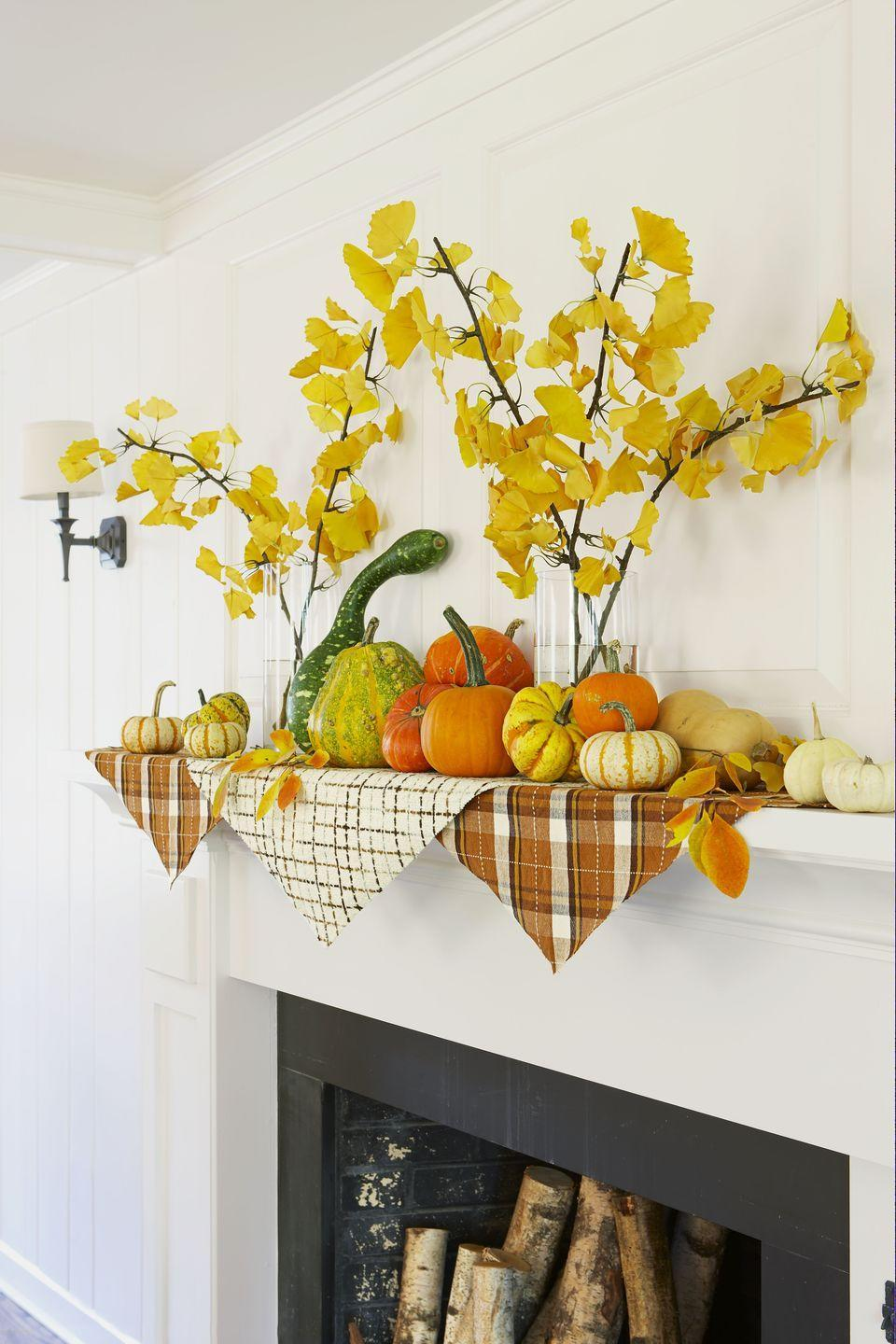 <p>Top pieces of plaid fabric with statement yellow foliage and charming pumpkins in varied sizes. </p>