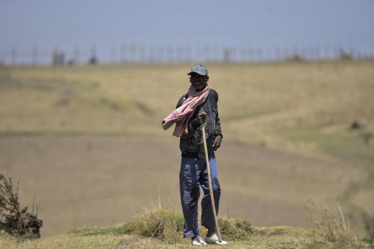 The crash site of Ethiopian Airlines Flight 302, which a year later sees little activity besides visits from mourners