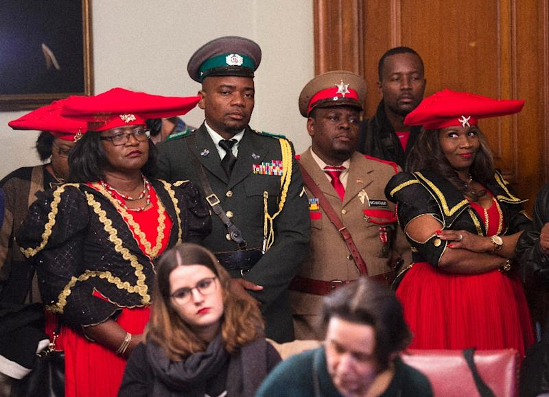 Members of the Namibian delegation listen as Herero chief Vekuii Rukoro speaks during a news conference March 16, 2017 in New York (AFP Photo/DON EMMERT)