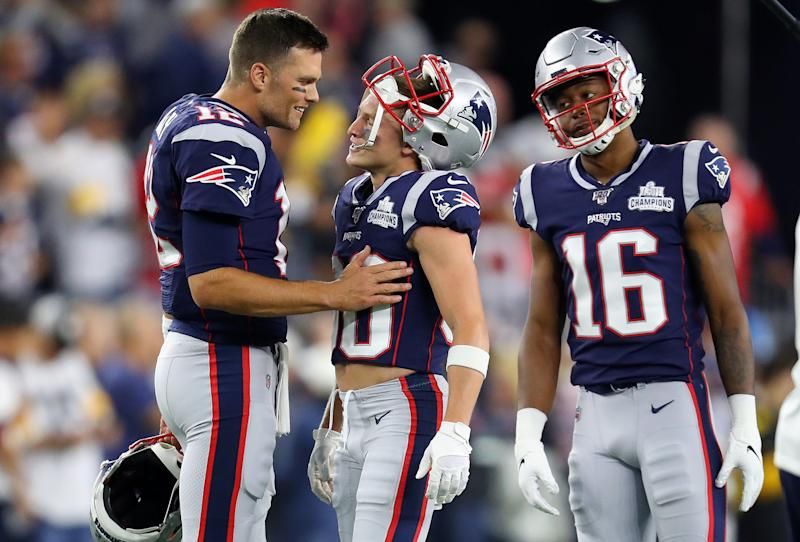 FOXBOROUGH, MASSACHUSETTS - SEPTEMBER 08: Tom Brady #12 of the New England Patriots talks with Gunner Olszewski #80 and Jakobi Meyers #16 before the game between the New England Patriots and the Pittsburgh Steelers at Gillette Stadium on September 08, 2019 in Foxborough, Massachusetts. (Photo by Maddie Meyer/Getty Images)