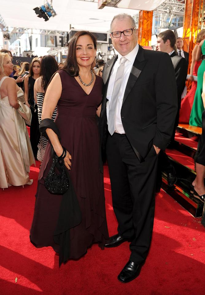 Ed O'Neill, right, and Catherine Rusoff arrive at the 65th Primetime Emmy Awards at Nokia Theatre on Sunday Sept. 22, 2013, in Los Angeles. (Photo by Frank Micelotta/Invision for Academy of Television Arts & Sciences/AP Images)