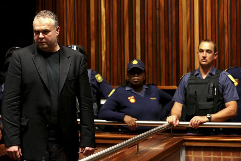 Radovan Krejcir, a Czech fugitive and businessman looks on during his court appearance on charges of kidnapping and attempted murder at the Palm Ridge court, east of Johannesburg