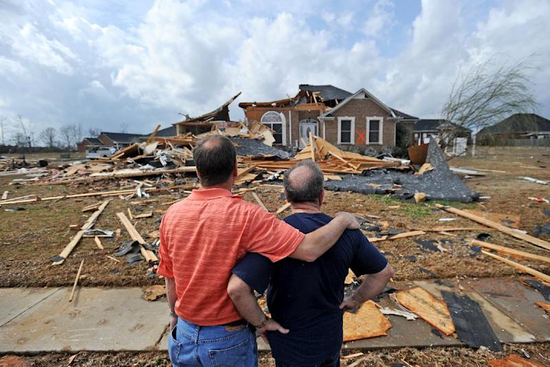 Jerry Vonderhaar, left, comforts Charles Kellogg after severe weather hit the Eagle Point subdivision in Limestone County, Ala. on Friday, March 2, 2012.  A reported tornado destroyed several houses in northern Alabama as storms threatened more twisters across the region Friday (AP Photo/The Decatur Daily,  Jeronimo Nisa)
