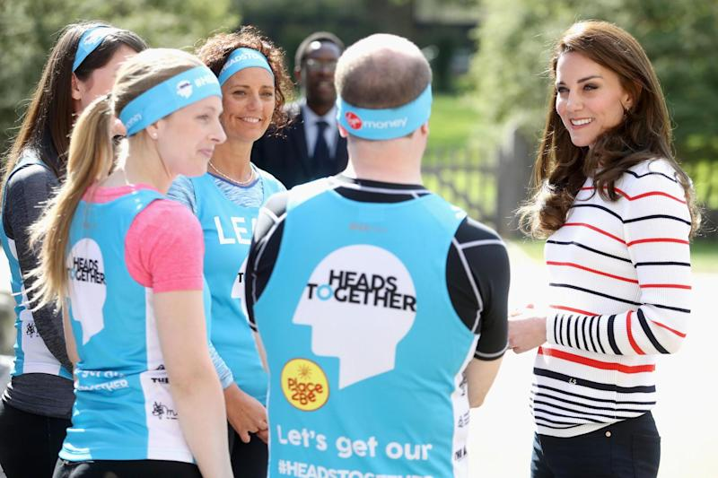 The Duchess of Cambridge speaks to runners from Team Heads Together at Kensington Palace in London: PA