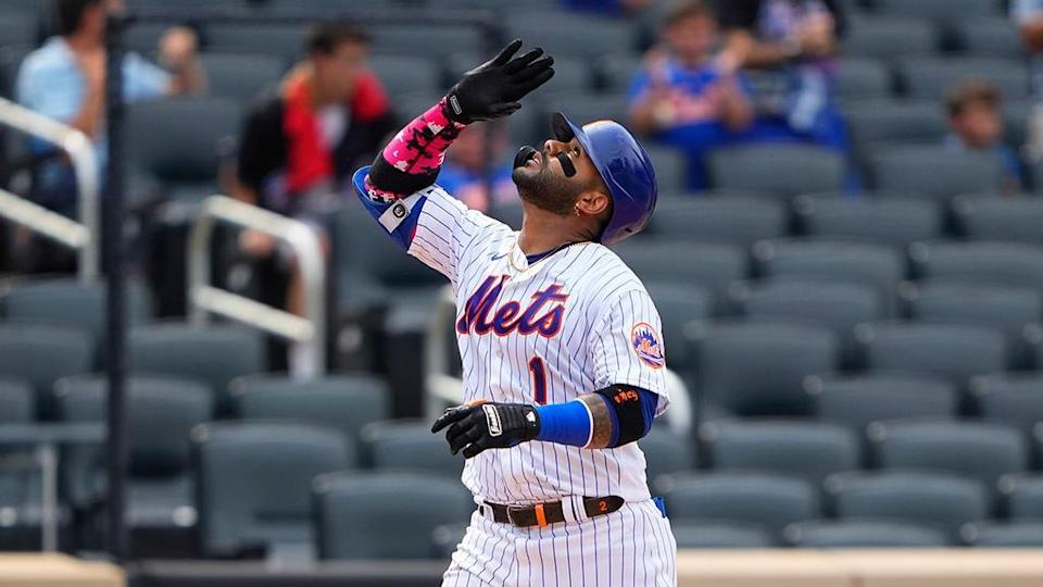 Jonathan Villar reacts to hitting a home run as he crosses home plate during the fifth inning against the Miami Marlins in 2021