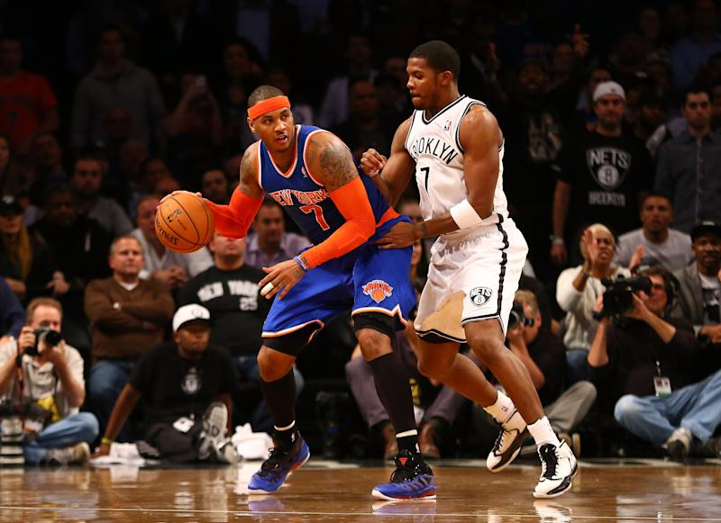 NEW YORK, NY - DECEMBER 11: Carmelo Anthony #7 of the New York Knicks dribbles against Joe Johnson #7 of the Brooklyn Nets during their game at the Barclays Center on December 11, 2012 in the Brooklyn borough of New York City. (Photo by Al Bello/Getty Images)