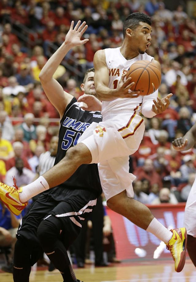 Iowa State guard Naz Long, right, passes the ball in front of Missouri-Kansas City center Isaac Kreuer during the first half of an NCAA college basketball game, Monday, Nov. 25, 2013, in Ames, Iowa. (AP Photo/Charlie Neibergall)