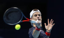 Diego Schwartzman of Argentina plays a return to Daniil Medvedev of Russia during their singles tennis match at the ATP World Finals tennis tournament at the O2 arena in London, Friday, Nov. 20, 2020. (AP Photo/Frank Augstein)