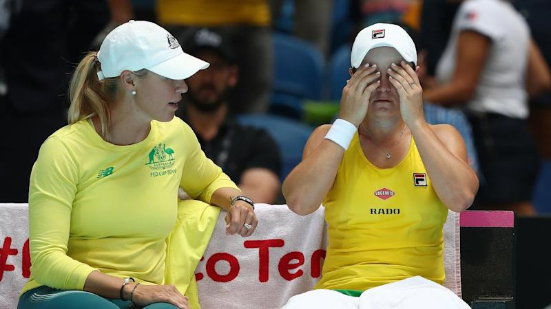 Ashleigh Barty (r) has been beaten in a three-set thriller to hand France a 2-1 Fed Cup advantage