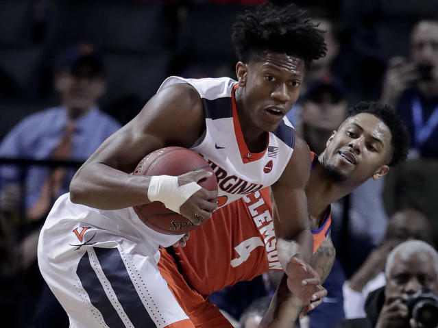 Virginia guard De'Andre Hunter (12) pulls down a rebound next to Clemson guard Shelton Mitchell (4) during the first half of an NCAA college basketball game in the Atlantic Coast Conference men's tournament semifinals Friday, March 9, 2018, in New York. (AP Photo/Julie Jacobson)